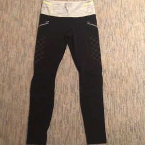 Black Lululemon leggings with detailed waist.
